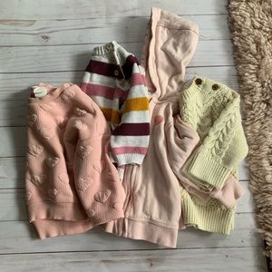 Set of baby girl sweaters